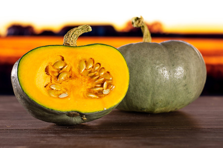 Group of one whole one half of fresh blue grey pumpkin