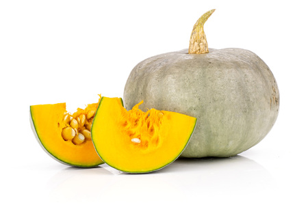 Group of one whole two slices of fresh blue grey pumpkin Stock Photo