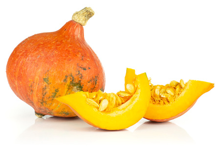 Group of one whole two slices of fresh red kuri pumpkin hokkaido variety isolated on white background