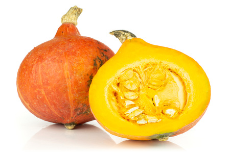 Group of one whole one half of fresh red kuri pumpkin hokkaido variety fresh cut section with seeds isolated on white background