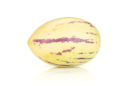 One whole fresh striped pepino melon isolated on white background Stock Photo