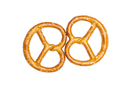 Group of two whole mini salted pretzels flatlay isolated on white background