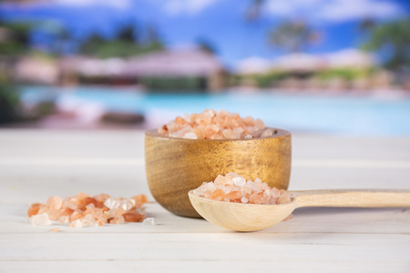 Lot of pieces of pink himalayan salt crystals in a spoon in resort