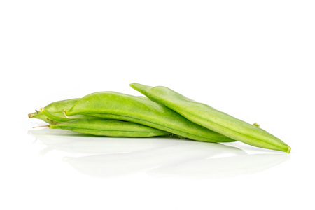 Group of three whole green sugar snap pea isolated on white background