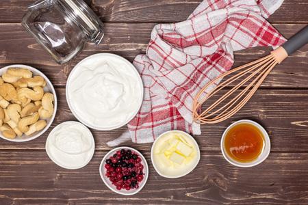 Ingredients. recipe step by step no bake cheesecake flatlay on brown wood