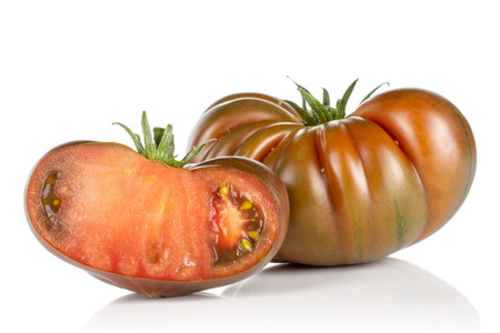 Group of one whole one half of meaty fresh tomato primora isolated on white background Stock Photo