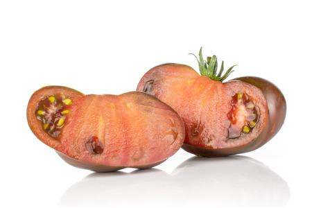 Group of two halves of fleshy fresh tomato primora isolated on white background