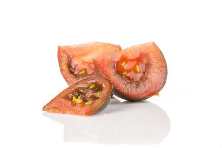 Group of three slices of fresh tomato primora isolated on white background