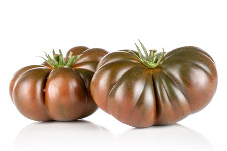 Group of two whole fresh tomato primora isolated on white background Stock Photo