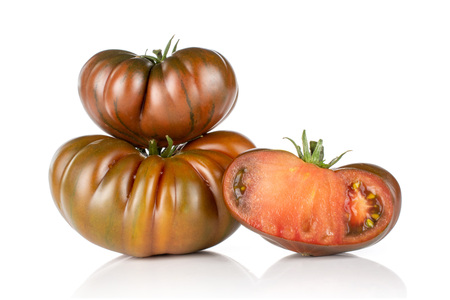 Group of two whole one half of glossy fresh tomato primora isolated on white background