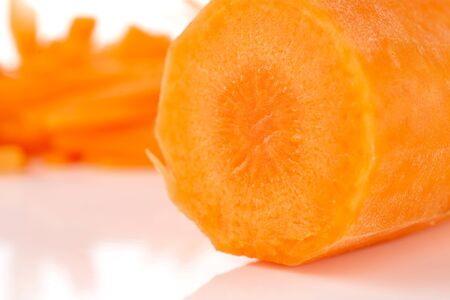 Macro closeup of one half lot of pieces of fresh orange carrot isolated on white background Stock Photo