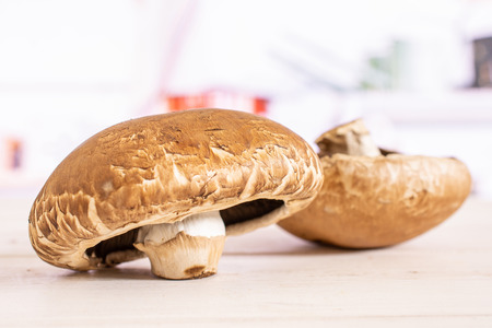 Group of two whole fresh brown mushroom portobello in a white kitchen Stock Photo