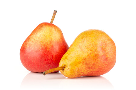 Group of two whole juicy fresh red pear isolated on white