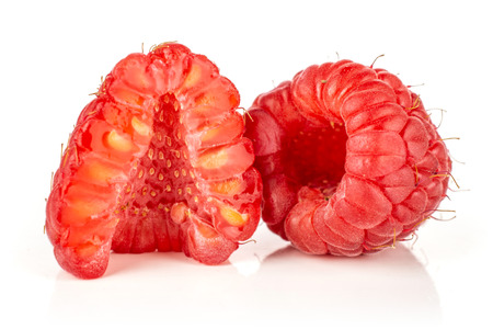 Group of one whole one half of fresh red raspberry cross section isolated on white Фото со стока