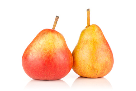 Group of two whole ripe fresh red pear isolated on white