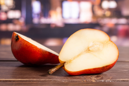 Group of two halves of fresh red pear in a restaurant