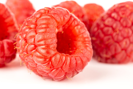 Lot of whole fresh red raspberry isolated on white