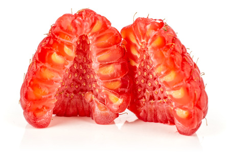 Group of two halves of fresh red raspberry cross section isolated on white Фото со стока
