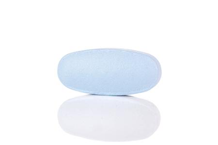 One whole light blue medical drug isolated on white background