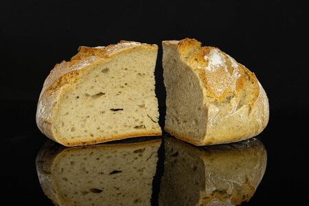 Group of two slices of fresh baked rye wheat bread isolated on black glass Archivio Fotografico