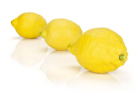 Group of three whole fresh yellow lemon placed diagonally in a line isolated on white background