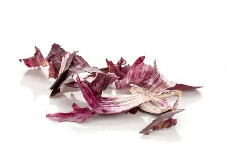 Lot of pieces of stale red onion isolated on white background