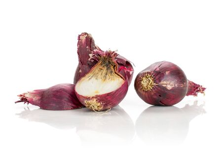 Group of two whole two halves of stale red onion isolated on white background