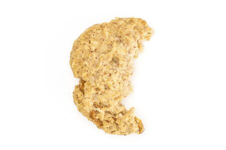 One half of oat crumble biscuit flatlay isolated on white background