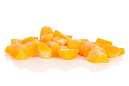 Lot of pieces of stale orange stale baby carrot isolated on white background Reklamní fotografie