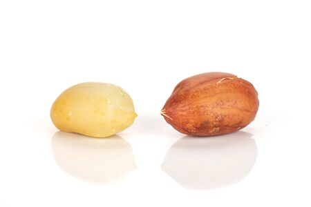 Group of two whole natural yellow peanut in closeup isolated on white background Imagens