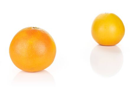 Group of two whole fresh pink grapefruit placed diagonally in line isolated on white background