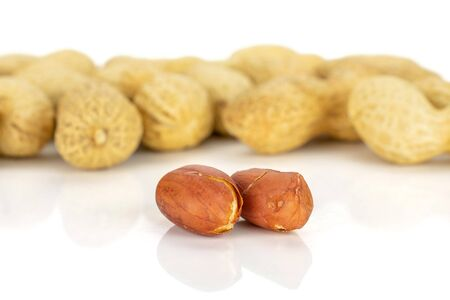 Lot of whole natural yellow peanut isolated on white background Imagens