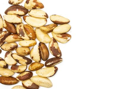 Lot of whole unshelled brazil nut copyspace on right flatlay isolated on white background Stock fotó