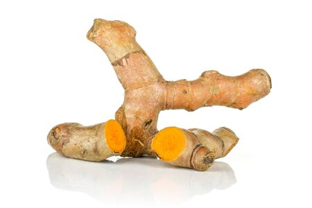 Group of one whole two halves of ripe bright turmeric rhizome isolated on white background