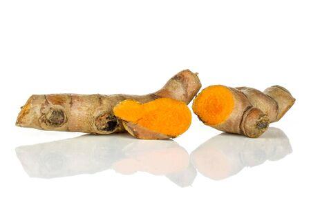Group of one whole one half one slice of bright turmeric rhizome orange flesh isolated on white background