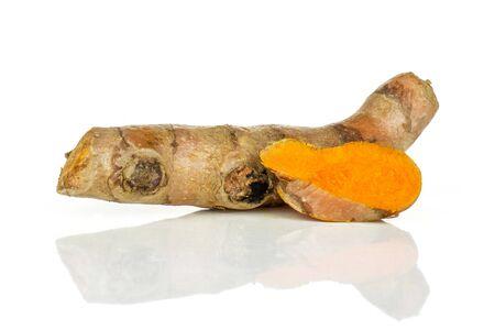 Group of one whole one slice of bright turmeric rhizome orange flesh isolated on white background