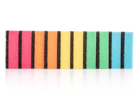 Group of ten whole cleaning kitchen sponge rainbow colours isolated on white background