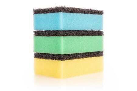 Group of three whole cleaning kitchen sponge yellow blue green isolated on white background Banco de Imagens
