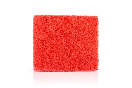 One whole red cleaning kitchen sponge isolated on white background