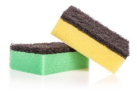 Group of two whole cleaning kitchen sponge green yellow isolated on white background Banco de Imagens