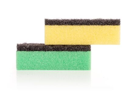 Group of two whole green and yellow cleaning kitchen sponge isolated on white background