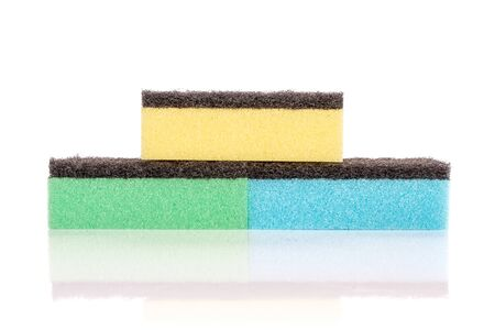 Group of three whole cleaning kitchen sponge pyramid isolated on white background