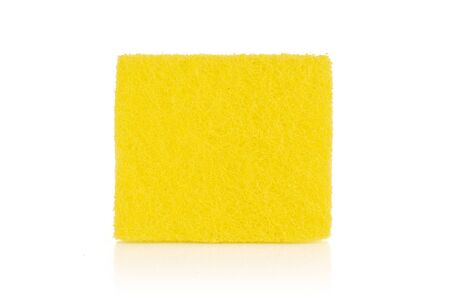 One whole yellow cleaning kitchen sponge isolated on white background