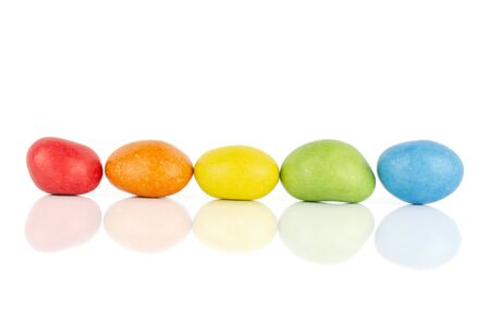 Group of five whole sugared nut dragee rainbow isolated on white background