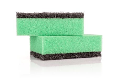 Group of two whole green cleaning kitchen sponge isolated on white background