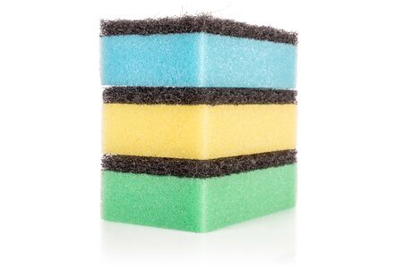 Group of three whole cleaning kitchen sponge one on top of another isolated on white background