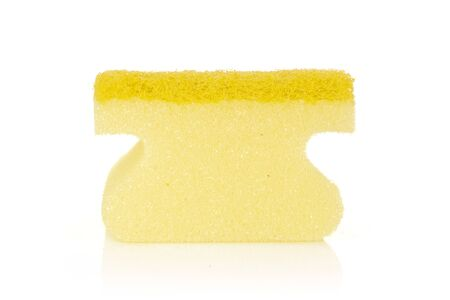 One whole yellow cleaning kitchen sponge letter shape isolated on white background Banco de Imagens
