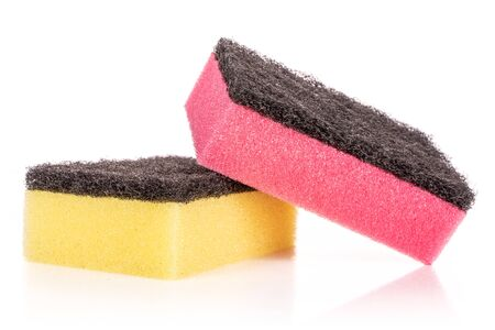Group of two whole cleaning kitchen sponge yellow pink isolated on white background