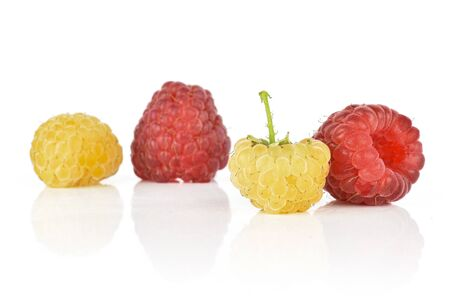 Group of two whole fresh golden hymalayan raspberry with two red berries isolated on white background
