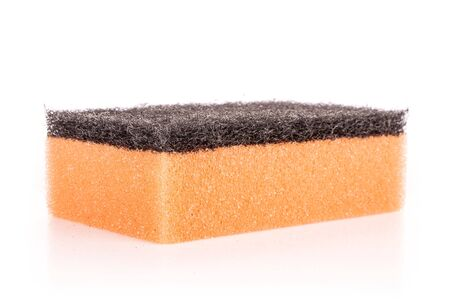 One whole orange cleaning kitchen sponge isolated on white background